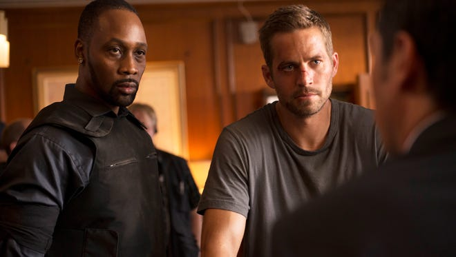 """RZA and Paul Walker in a scene from """"Brick Mansions."""""""