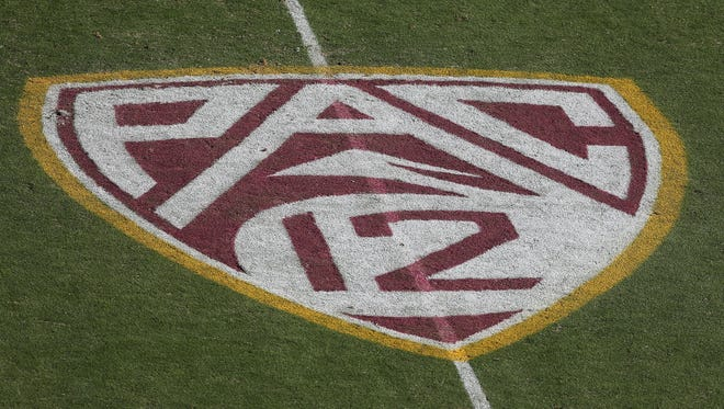 The Pac-12 conference logo is pained on the filed at Sun Devil Stadium on October 19, 2013 in Tempe.