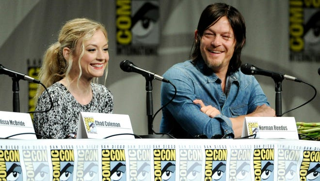 """Emily Kinney, left, and Norman Reedus attend """"The Walking Dead"""" panel on Day 2 of Comic-Con International on Friday, July 25, 2014, in San Diego."""