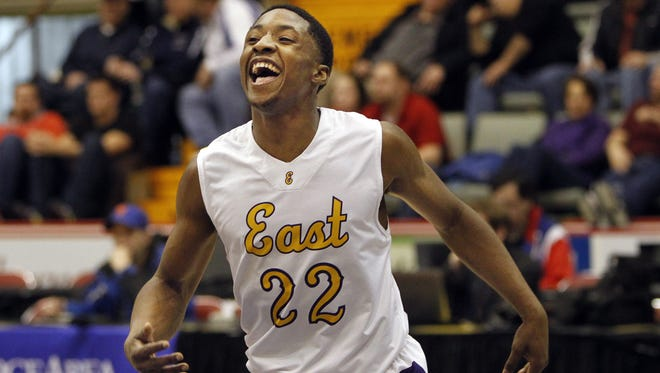 East High's Dontay Caruthers celebrates as the final seconds tick away in East?s 57-45 victory over Red Hook during NYSPHSAA Class A semifinal boys basketball action Saturday at the Glens Falls Civic center in Glens Falls.  KRIS J. MURANTE/STAFF PHOTOGRAPHER East High's Dontay Caruthers lets out a scream as the final seconds tick away and East High advanced to the state title game with a 57-45 victory over Red Hook during NYSPHSAA Class A semifinal boys basketball action between the East High Orientals and the Red Hook Raiders at the Glens Falls Civic center in Glens Falls Saturday morning, March 15, 2014. East High advanced to the state title game with a 57-45 victory over Red Hook.