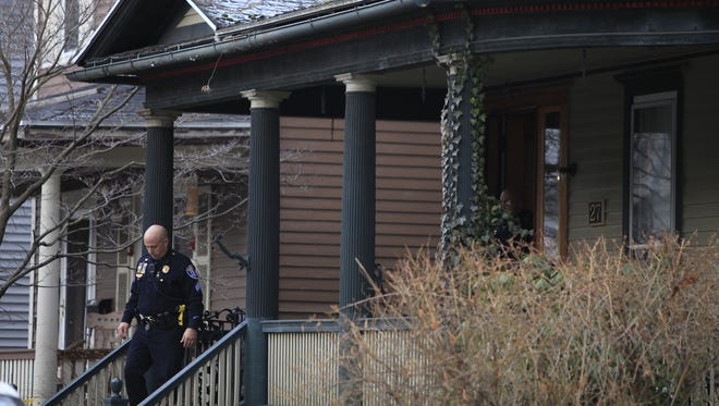 Police continue their investigation at 27 Rowley St., the home of Dr. William Lewek, on Jan. 17.