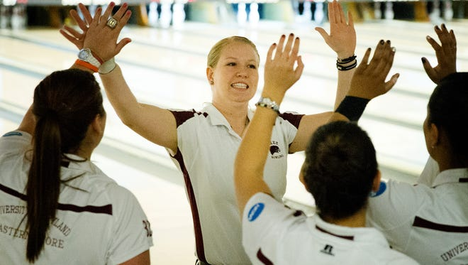 Megan Buja is congratulated by temmates after a shot during the 2013 NCAA Championships.