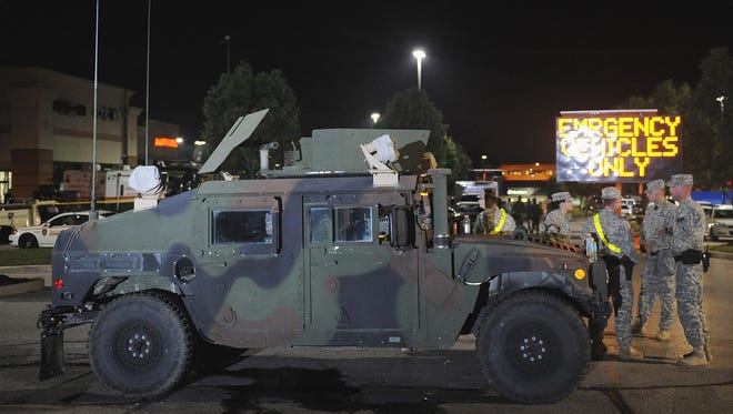 Missouri National Guard personnel stand guard during a protest on West Florissant Avenue in Ferguson, Missouri on August 18, 2014. Gov. Jay Nixon order the troops to begin a systematic withdrawal on Aug. 21. 2014.
