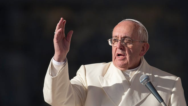 Pope Francis, pictured during a Dec. 18, 2013, blessing in St. Peter's Square, warned Vatican administrators on Dec. 21 against gossip and falling into mediocrity.