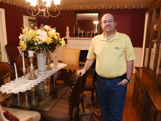 Greg Spaun stands in the dining room of his LaGrange