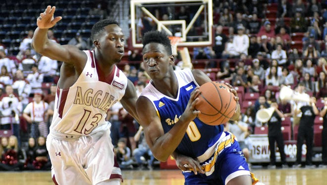New Mexico State's Sidy N'Dir pressures a Cal State Bakersfield Jarkel Joiner forcing him to give up the ball on Thursday night.