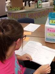 Kalie McCrea preps for fifth-grade math at Belaire Elementary.