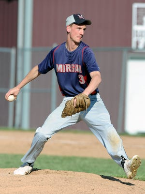 Morgan's Mason Edgell delivers a pitch against John Glenn during a regular season game in New Concord during the regular season. Edgell signed a letter of intent to pitch at Ohio Valley University on Friday.