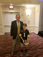 Colton Barker, 10, met Kirk Ferentz when he was the team's kid captain in 2014.