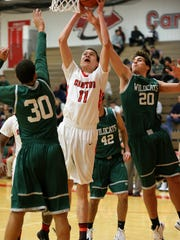 Canton's Logan Ryan (No. 11) goes up for a bucket while