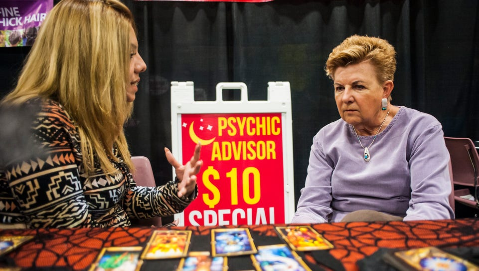 Jane John, left, gives Mary Reitz a tarot reading during
