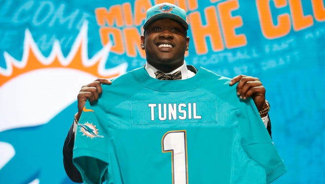 Former Ole Miss offensive tackle Laremy Tunsil was taken No. 13 overall by the Miami Dolphins after a difficult Thursday night.