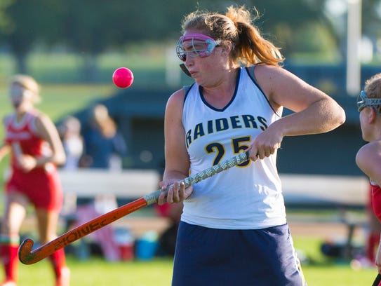 Elco's Hannah Williams tries to control the ball out