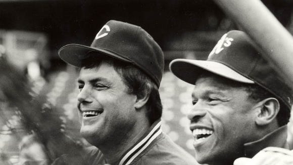 Reds manager Lou Piniella (left) shares a laugh with Oakland's Rickey Henderson before teh start of Game 1 of the 1990 World Series on Oct. 16, 1990 at Riverfront Stadium.