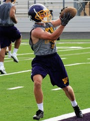 Wylie tailback Brady Horn catches a pass during Monday