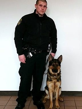 K-9 Devin, with his handler, Steuben County Sheriff's deputy Thomas Nybeck, recently received new body armor, thanks to a charitable donation.