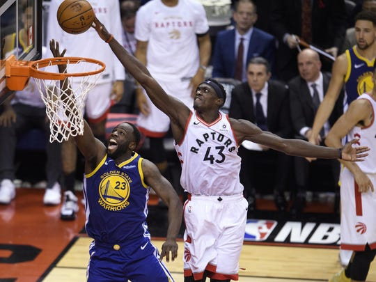 Toronto Raptors forward Pascal Siakam (43) blocks a shot by Golden State Warriors forward Draymond Green (23) during the second half Thursday in Game 1 of the NBA Finals. Toronto won 118-109.