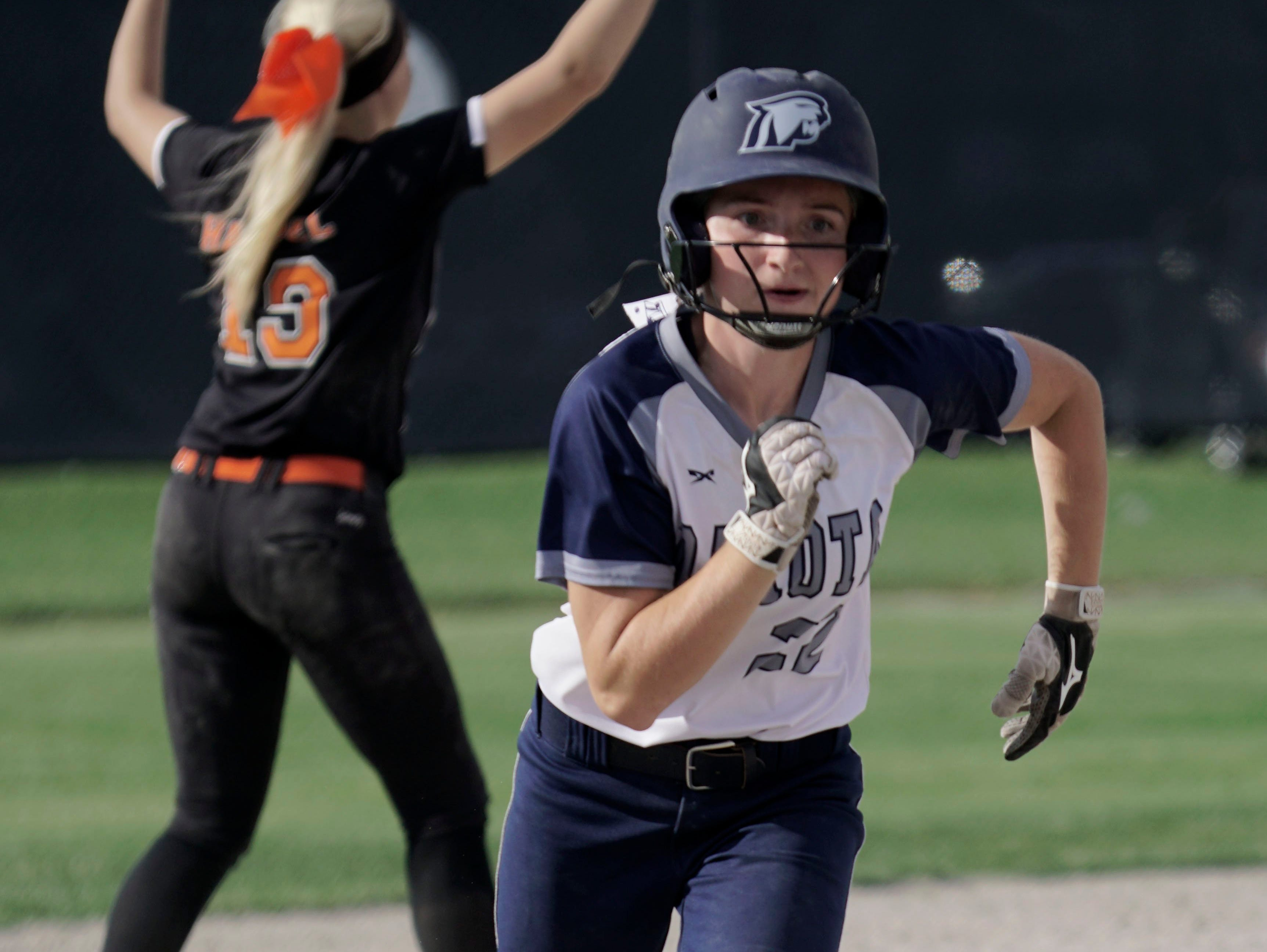 Macomb Dakota's Melissa Charbonneau sprints to third base during Dakota's 9-1 win over Utica Tuesday at Sterling Heights Stevenson.