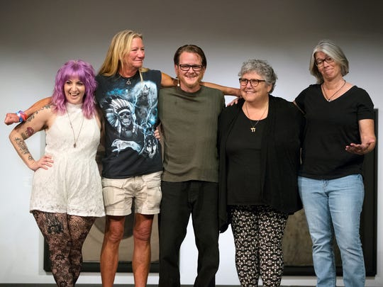 "Angela Page, left, Mary Dugan, Matthew Fread, Celia Rubin and Robyn George celebrate after sharing the stories behind their tattoos recently at the Southwest Florida Storytellers Project at the Sidney and Berne Davis Art Center in downtown Fort Myers. ""Tattoo Tales"" was presented by The News-Press and The Naples Daily News. Go to tickets.news-press.com to learn about upcoming events."