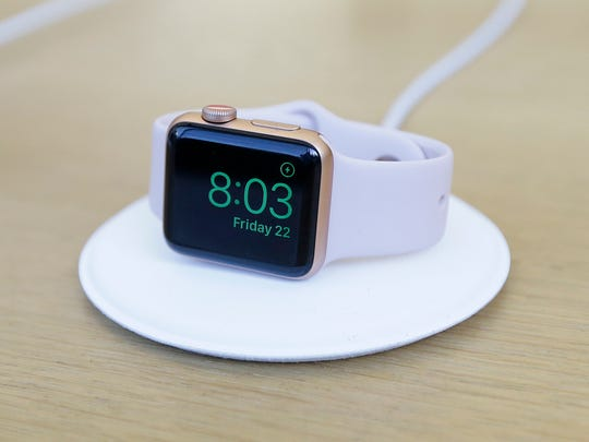An Apple Watch is shown on display at an Apple Store
