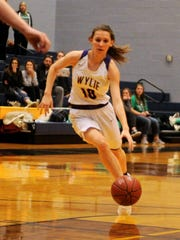 Wylie's Abbey Henson (10) drives into the lane during