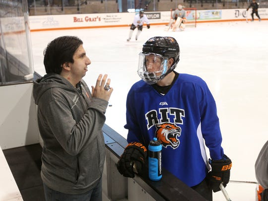 Joe Vicario, affectionately known as Part Time Joe, chats with RIT's Myles Powell before practice.