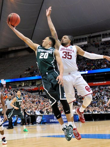 Michigan State Spartans guard Travis Trice (20) shoots