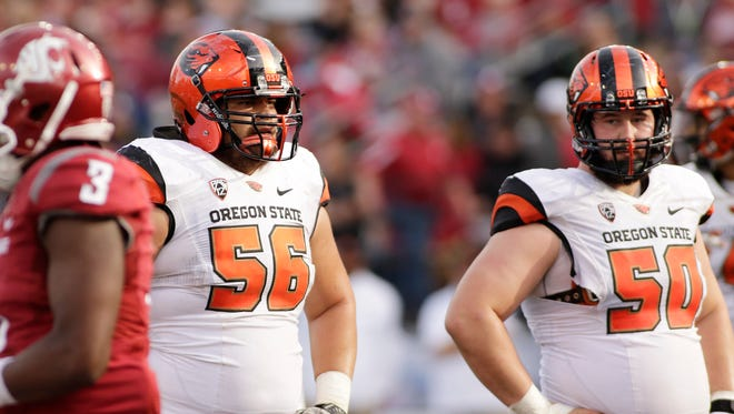 Oregon State offensive lineman Isaac Seumalo (56) and his teammate offensive lineman Josh Mitchell (50) prepare for the next play during the second half of an NCAA college football game, Saturday, Oct. 17, 2015, in Pullman, Wash.