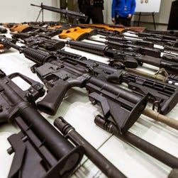 A variety of military-style semiautomatic rifles obtained during a buy-back program are displayed at Los Angeles police headquarters in 2012.