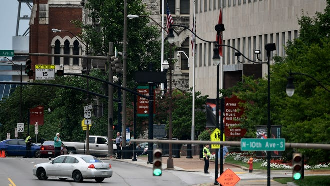 Metro Police shutdown several blocks of Broadway as they investigate a suspicious package outside the downtown post office Wednesday July 20, 2016, in Nashville, Tenn.