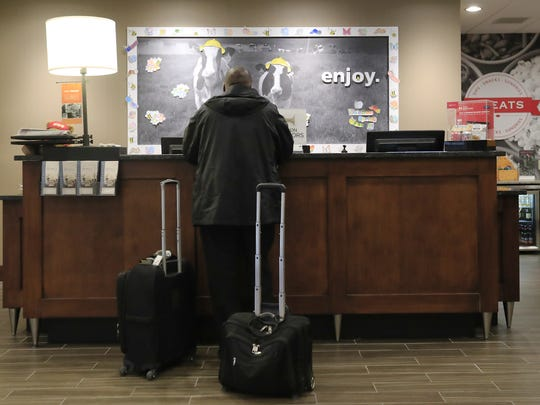 A customer checks in at the Hampton Inn in downtown Green Bay. County Executive Troy Streckenbach has proposed using a portion of room taxes collected in the county to fund a variety of building and infrastructure projects.