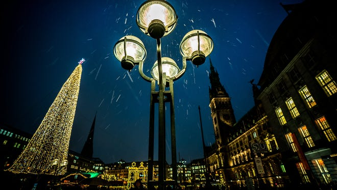 Sleet trickles down at the Christmas market in Hamburg, Germany.