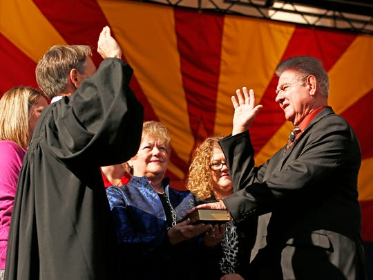 Arizona Mine Inspector Joe Hart takes the oath of office from Arizona Supreme Court Chief Justice Scott Bales during Inaugural ceremonies on Monday, Jan. 5, 2015 at the Arizona State Capitol Courtyard in Phoenix AZ. POOL PHOTO by Rob Schumacher