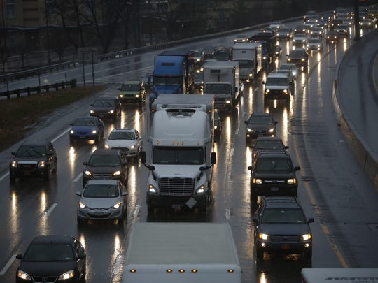 Rain from a nor'easter slows drivers on eastbound Interstate