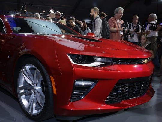Media surrounds the sixth-generation 2016 Chevrolet Camaro SS.