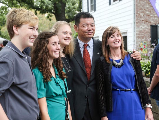 Daniel Wang, China Window Group, center, has his photo