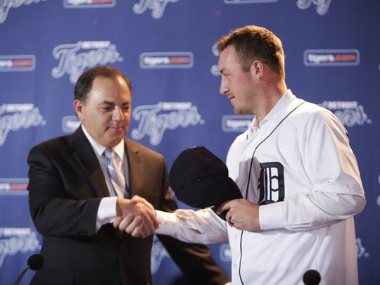 Detroit Tigers General Manager Al Avila shakes hands with Jordan Zimmermann after putting on his Detroit Tigers jersey after being named their new right-handed pitcher during a press conference on Monday November 30, 2015 at Comerica Park in Detroit.