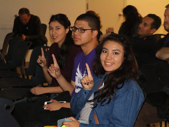 Activists from the One Phx ID coalition attend a Phoenix