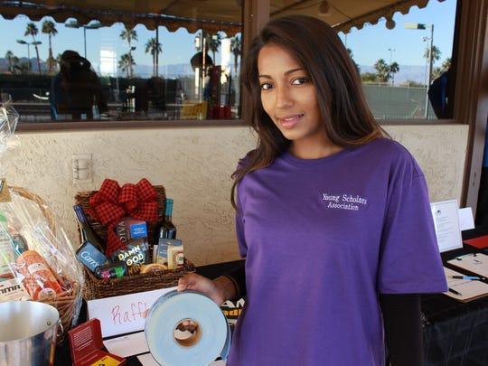 YSA volunteer Tarryn Joshua selling raffle tickets.
