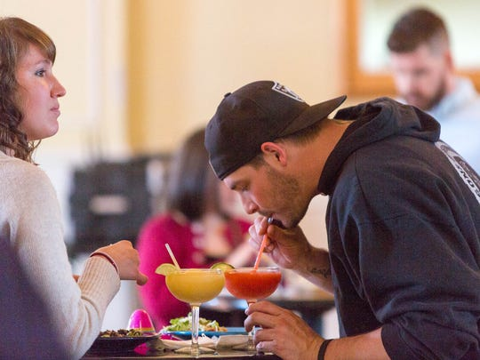 Guests enjoy margaritas at The Rio's Agave Room.
