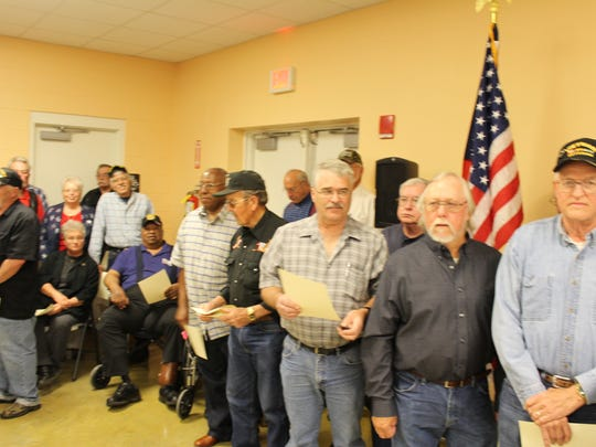Veterans stand for applause after receiving their proclamations and plaques.