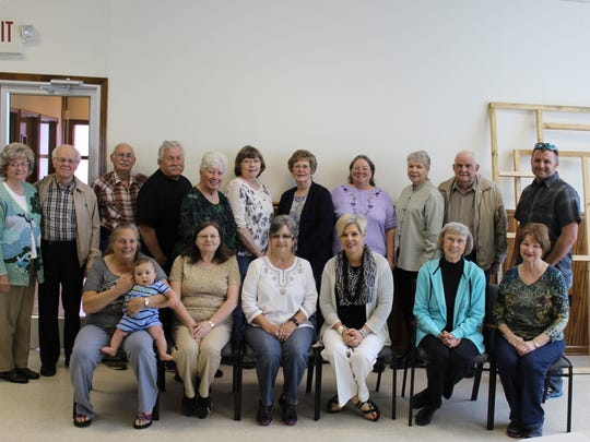 Volunteers for Bethesda Mission pose for a photo.