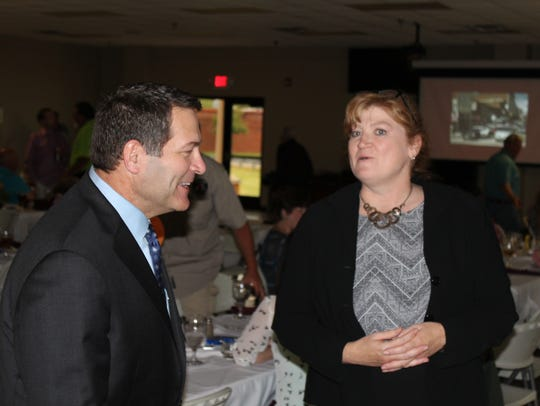 Senator Mark Green speaks with Kathy Freed during the