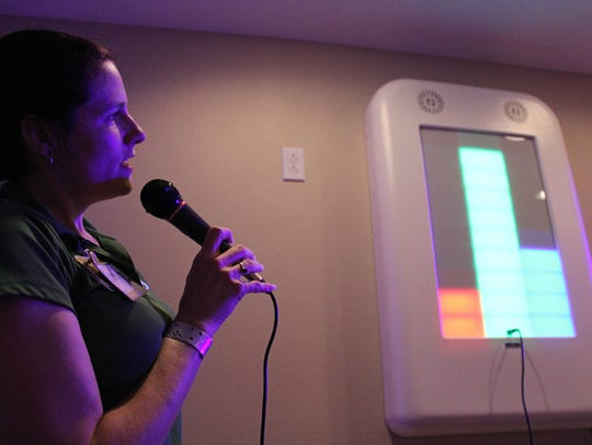 Meeker shows how a special device can help speech therapists