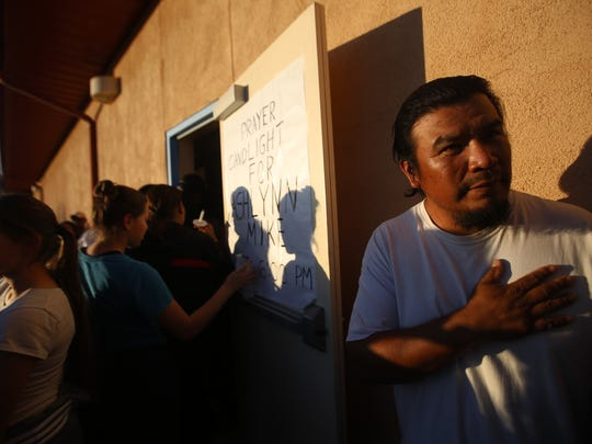Shawn Mike, a spokesman for the Mike family, speaks outside the San Juan Chapter house in Lower Fruitland on Tuesday at a vigil for his cousin, Ashlynne Mike, who police say was abducted and murdered.