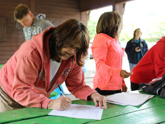 Carolyn Hale signs up for the Marathon in a Month program,