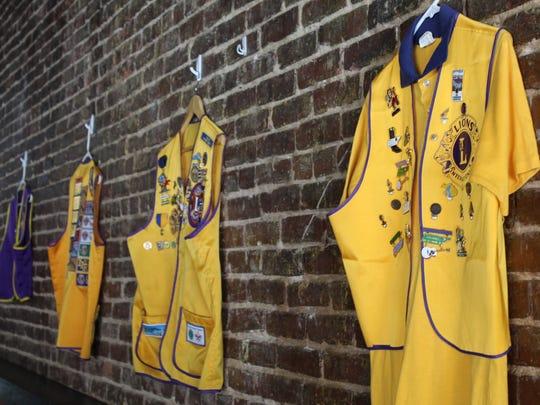 Lions Club vests adorn the walls at Shamrocks and Shenanigans.