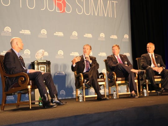 FSU's Jimbo Fisher, middle, speaks on a leadership panel to Gov. Rick Scott with Miami's Mark Richt, far right, and Florida's Jim McElwain during the Degrees for Jobs Summit in Orlando on Thursday.