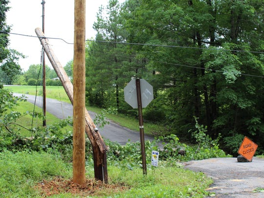 A utility pole crushed by storm damage shut down a