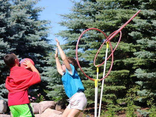 Kids participate and observe a game of Quidditch, inspired